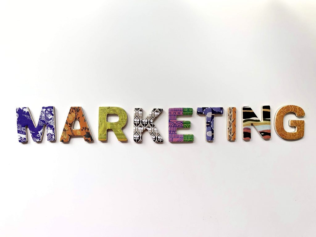 multicolored marketing freestanding letter